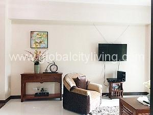 Living Room Eight Forbestown Road One Bedroom 1BR Condo For Sale in Bonifacio Global City